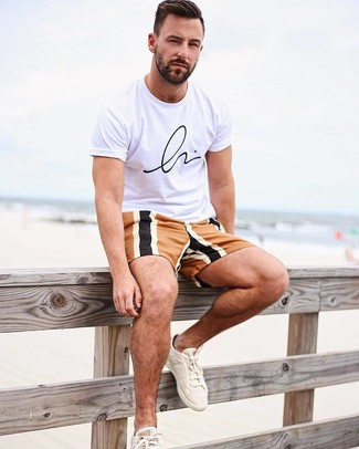 How to wear: beige canvas low top sneakers, multi colored shorts, white and black print crew-neck t-shirt