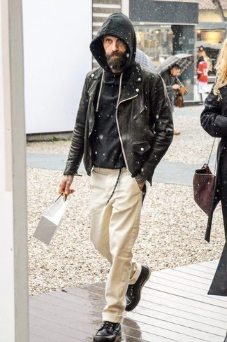How to Wear a Black Hoodie For Men: Who said you can't make a style statement with a casual ensemble? You can do that easily in a black hoodie and beige chinos. Infuse your look with an air of elegance by finishing with black leather casual boots.