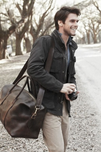 How to wear: dark brown leather holdall, beige chinos, blue denim shirt, black field jacket
