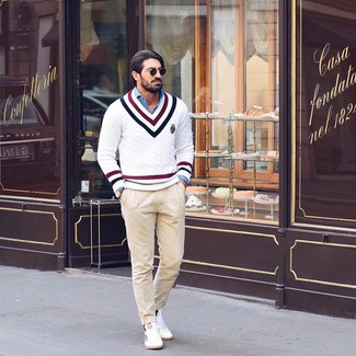 How to wear: white low top sneakers, beige chinos, blue chambray long sleeve shirt, white chevron v-neck sweater
