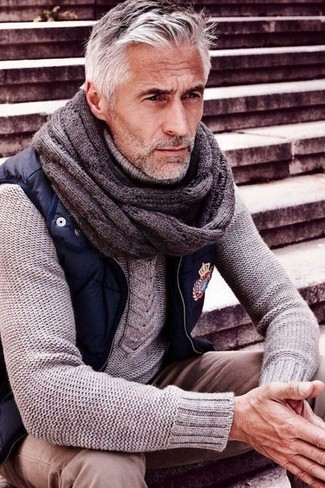 How to wear: grey knit tie, beige chinos, grey cable sweater, navy gilet