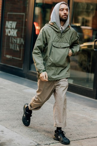 How to wear: black leather athletic shoes, beige chinos, grey hoodie, olive windbreaker