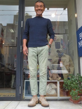 How to Wear a Navy Crew-neck Sweater For Men: No matter where you go over the course of the day, you'll be stylishly ready in this off-duty pairing of a navy crew-neck sweater and mint chinos. Complement this outfit with beige suede desert boots et voila, this getup is complete.