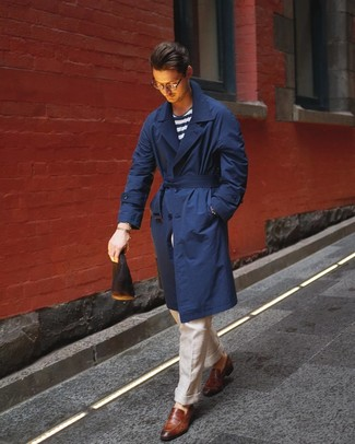 How to wear: brown leather loafers, beige linen dress pants, white and navy horizontal striped crew-neck t-shirt, navy trenchcoat