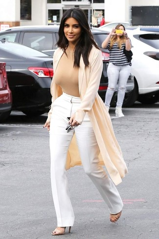 Kim Kardashian wearing Beige Duster Coat, Tan Crew-neck T-shirt, White Flare Pants, Beige Leather Heeled Sandals