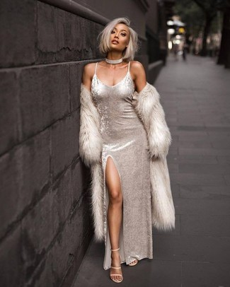 Try teaming outerwear with a white velvet maxi dress for a glam and trendy getup. Beige leather heeled sandals complement this getup very well. This outfit is super comfortable and will help you out in winter-to-spring weather.