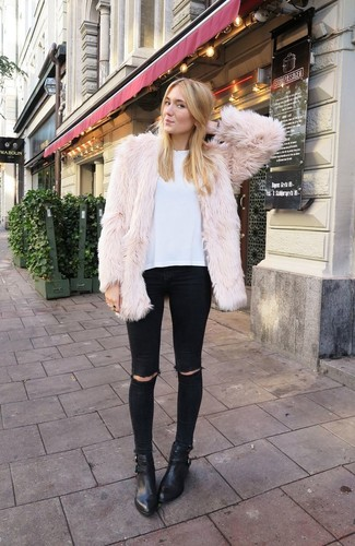 Effortlessly blurring the line between chic and casual, this combination of a beige fur jacket and black distressed skinny jeans is likely to become one of your favorites. Round off this look with black leather booties.