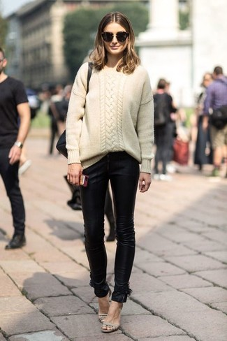 How to wear: black sunglasses, beige leather heeled sandals, black leather skinny jeans, beige cable sweater