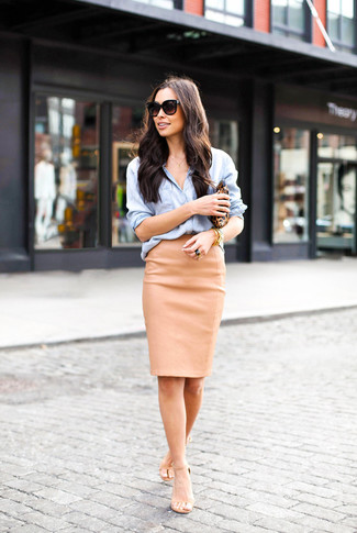 How to wear: brown leopard leather clutch, beige leather heeled sandals, tan leather pencil skirt, light blue chambray dress shirt