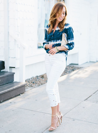 How to wear: beige straw clutch, beige leather heeled sandals, white capri pants, navy and white tie-dye dress shirt