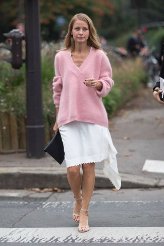 How to wear: black leather clutch, beige leather heeled sandals, white casual dress, pink oversized sweater