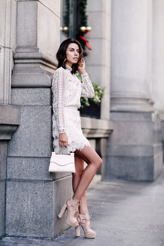 How to wear: white leather clutch, beige suede heeled sandals, white fringe mini skirt, white eyelet long sleeve blouse
