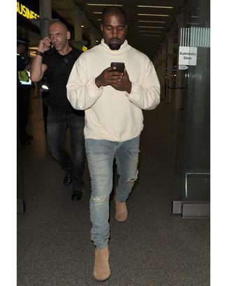 Kanye West wearing Beige Hoodie, Blue Ripped Skinny Jeans, Beige Suede Chelsea Boots