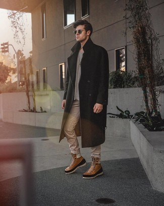 How to wear: brown leather casual boots, beige jeans, grey crew-neck sweater, black overcoat
