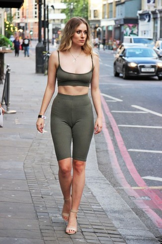 How to wear: beige leather heeled sandals, olive bike shorts, olive cropped top