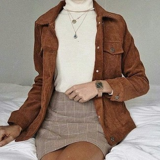How to wear: tan leather watch, beige plaid mini skirt, white turtleneck, brown corduroy shirt jacket
