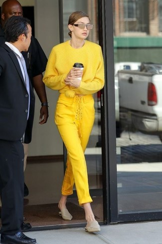 How to wear: gold sunglasses, beige leather mules, yellow skinny pants, yellow oversized sweater