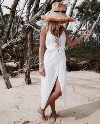 How to wear: silver bracelet, beige necklace, khaki straw hat, white linen wrap dress