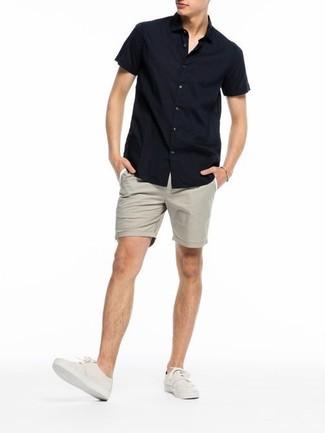 How to wear: beige plimsolls, beige shorts, black short sleeve shirt