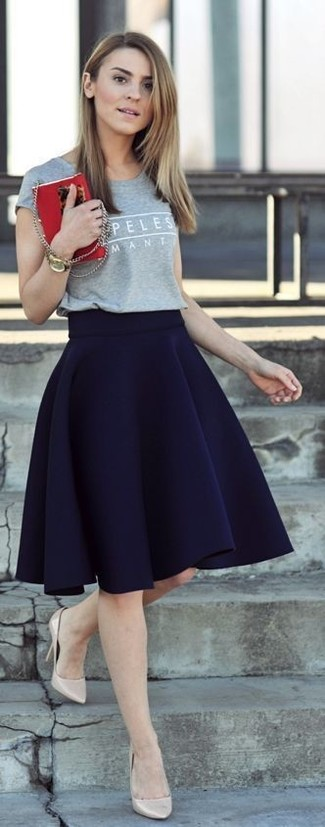 How to wear: gold watch, beige leather pumps, navy skater skirt, grey print crew-neck t-shirt
