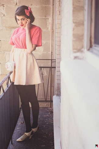 How to wear: hot pink bow-tie, beige leather pumps, pink skater skirt, hot pink crew-neck t-shirt