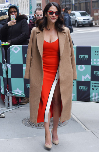 How to Wear a Red Sheath Dress: Pairing a red sheath dress and a camel coat is a surefire way to infuse your current styling lineup with some sophistication. Look at how nice this look is finished off with a pair of beige suede pumps.