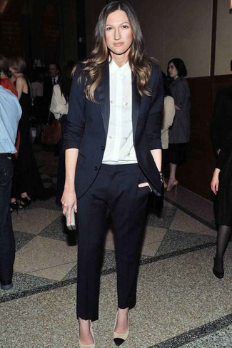 How to wear: grey leather clutch, beige leather pumps, white silk dress shirt, navy suit