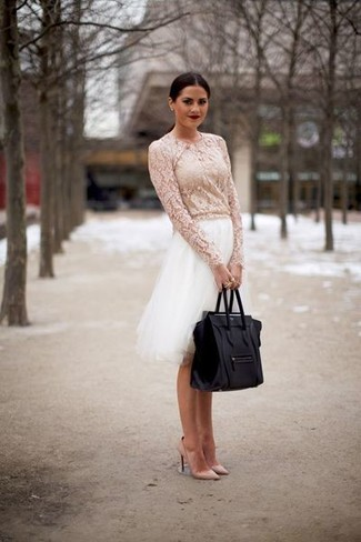 How to Wear a White Lace Long Sleeve Blouse: Wear a white lace long sleeve blouse and a white tulle full skirt to pull together an absolutely stylish and current off-duty outfit. Consider a pair of beige leather pumps as the glue that will tie your outfit together.