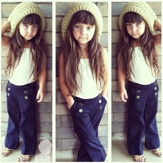 How to Wear a Beige Beanie For Girls: Suggest that your little one dress in a white tank top and a beige beanie for a fun day out at the playground. As for footwear your little one will love beige sandals for this look.