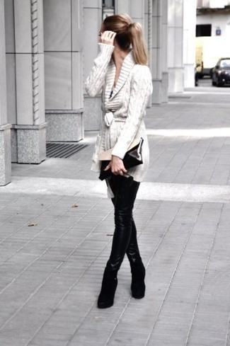 How to wear: beige shawl cardigan, black leather leggings, black suede wedge ankle boots, black and white leather clutch