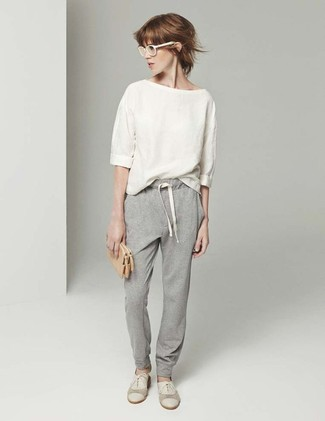 How to wear: beige short sleeve blouse, grey sweatpants, beige suede oxford shoes, white sunglasses