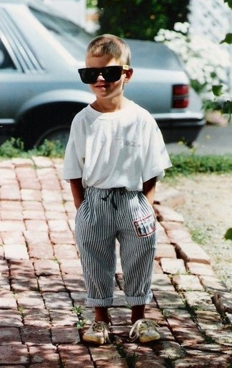 How to Wear Beige Sneakers For Boys: Suggest that your little one wear a white t-shirt and grey sweatpants for a fun day in the park. As for footwear your little guy will love beige sneakers for this ensemble.