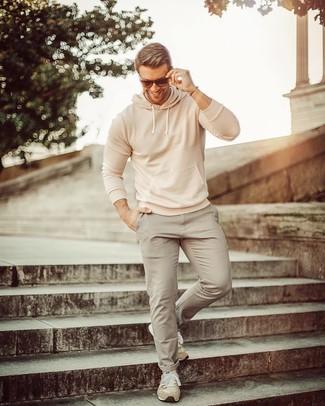 How to wear: beige suede athletic shoes, grey chinos, beige hoodie