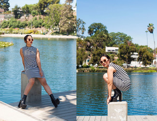 How to wear: beige sunglasses, black chunky leather ankle boots, white and black horizontal striped shift dress