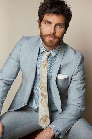 How to wear: white pocket square, beige floral tie, light blue vertical striped dress shirt, light blue suit
