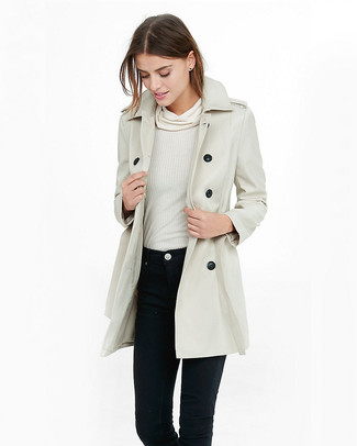 How to wear: beige trenchcoat, white cowl-neck sweater, black skinny jeans