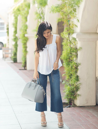 How to Wear Navy Denim Culottes: A white sleeveless top and navy denim culottes are a great go-to combination to have in your wardrobe. Dial up the wow factor of your ensemble by wearing a pair of beige leather wedge sandals.