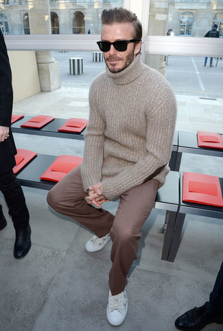 David Beckham wearing Beige Wool Turtleneck, Brown Wool Dress Pants, White Print Leather Low Top Sneakers