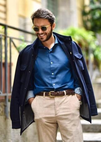 How to wear: tan sunglasses, dark brown woven leather belt, blue dress shirt, navy field jacket