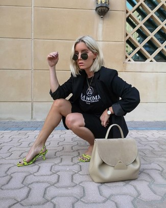How to wear: green-yellow leather heeled sandals, black bike shorts, black and white print crew-neck t-shirt, black blazer