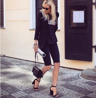 How to wear: black suede heeled sandals, black denim bike shorts, black and white print crew-neck t-shirt, black blazer
