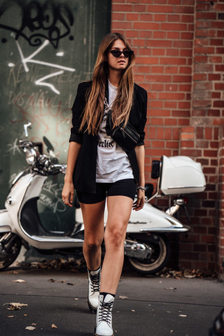 How to wear: white leather lace-up flat boots, black bike shorts, white and black print crew-neck t-shirt, black blazer