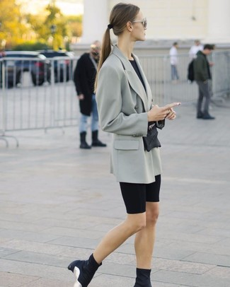 How to wear: black elastic ankle boots, black bike shorts, black crew-neck t-shirt, grey double breasted blazer