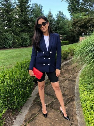 How to wear: black leather pumps, black bike shorts, white crew-neck t-shirt, navy double breasted blazer
