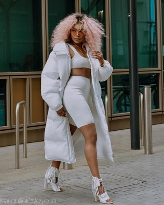 How to wear: white fringe leather heeled sandals, white bike shorts, white cropped top, white puffer coat