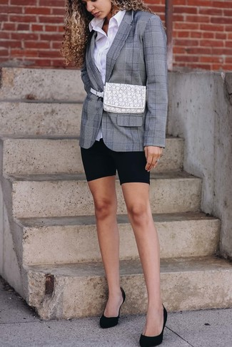 How to Wear a Grey Plaid Blazer For Women: A grey plaid blazer and black bike shorts matched together are a total eye candy for girls who love ultra-cool combinations. You can get a bit experimental when it comes to shoes and complement this ensemble with a pair of black suede pumps.
