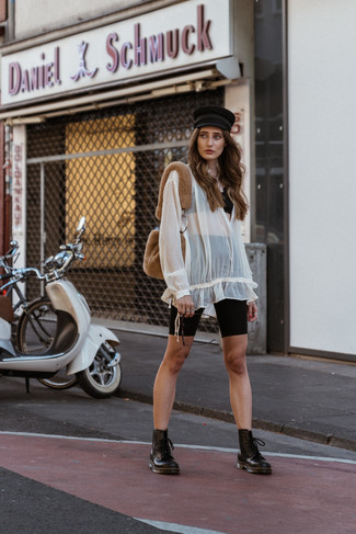 How to wear: black leather lace-up flat boots, black bike shorts, white chiffon peasant blouse, black lace cropped top