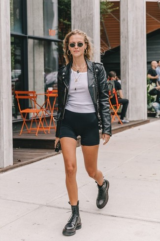 How to wear: black leather lace-up flat boots, black bike shorts, white tank, black leather biker jacket