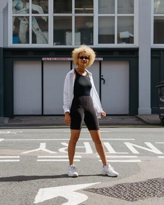 How to wear: white athletic shoes, black bike shorts, black tank, white windbreaker