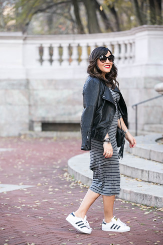 How to wear: black quilted leather biker jacket, grey horizontal striped bodycon dress, white and black leather low top sneakers, black leather crossbody bag